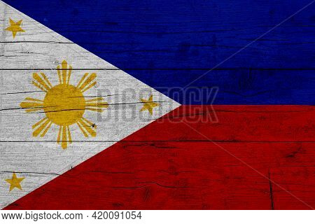 Flag Of Philippines. Wooden Texture Of The Flag Of Philippines.