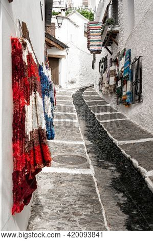 Pampaneria, Granada - September 01, 2020: View Of The White Streets With Typical Products Shops Of T