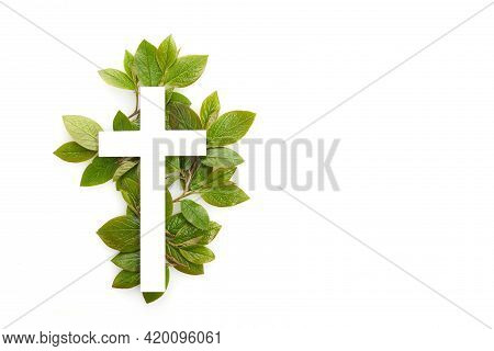 The Christianity Cross Of Green Leaves. Baptism, Easter, Church Holiday Background