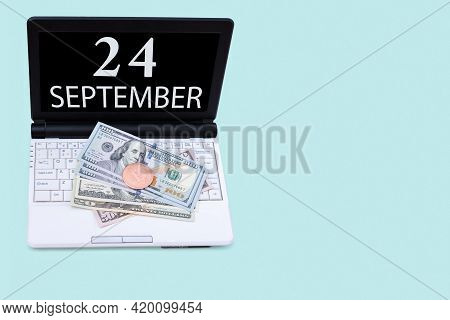 24th Day Of September. Laptop With The Date Of 24 September And Cryptocurrency Bitcoin, Dollars On A