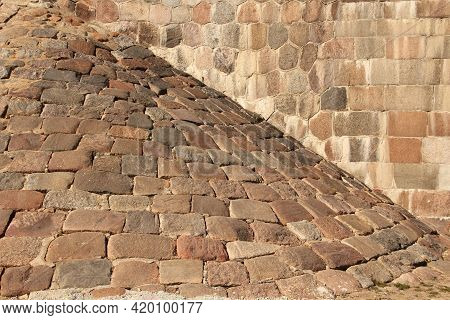 Ancient Pastel Colour Random Sized Stones And Bricks Wall And Rampart