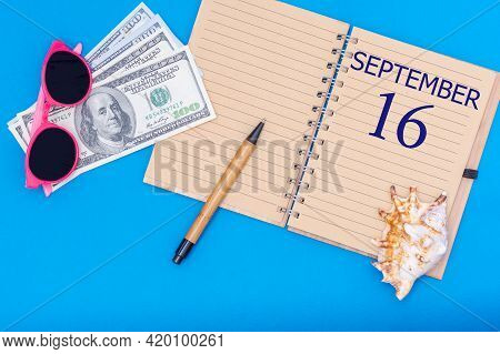 16th Day Of September. Travel Concept Flat Lay - Notepad With The Date Of 16 September Pen, Glasses,