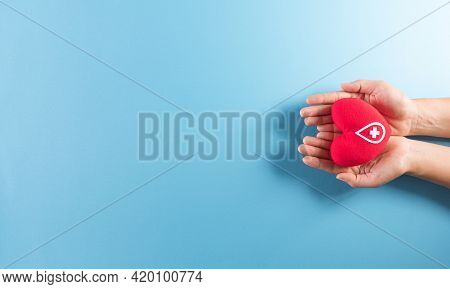 Medical And Donor Concepts. Hand Holding A Handmade Red Heart With A Sign Or Symbol Of Blood Donatio