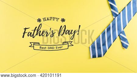 Happy Father's Day Background Concept Made From Beautiful Tie On Pastel Yellow Background.