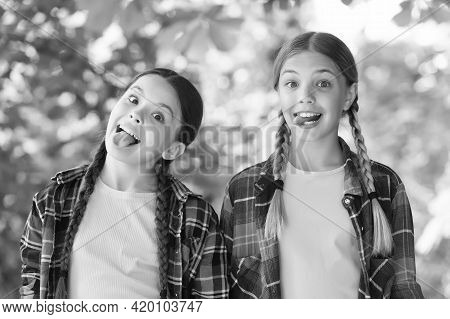 Day Full Of Fun. Carefree Kids Posing Outdoor. Positive Models. Casual Hipsters Outfit. Portrait Of