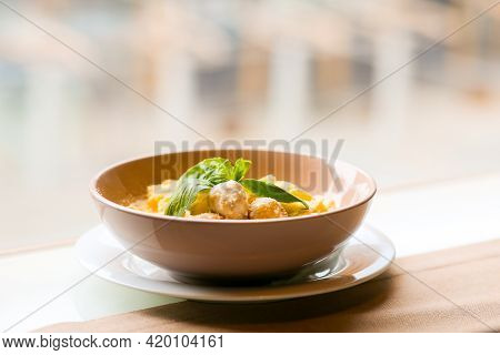 Tagliatelle With Rabbit Meatballs. Meatballs In A Creamy Sauce With Pasta. Pasta With Meat And Parme