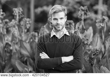 Young Unshaven Man Outdoor. Male Beauty And Fashion. Guy With Bristle Wear Purple Sweater. Concept O