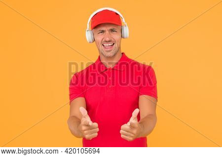 Let Music Speak. Happy Man Give Thumbs Ups Yellow Background. Enjoying Favorite Music. Handsome Guy