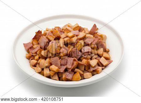 Finely Chopped, Fried Sausage And Bacon On A White Plate