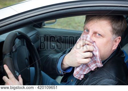 The Driver Covered His Nose With A Handkerchief From Strong Gases Auto Air Pollution.
