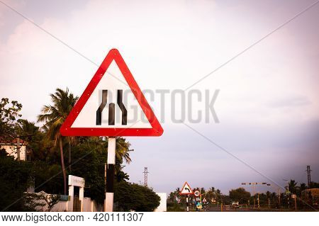 Indian Road Cautionary Sign Indicating Dual Carriageway Is Ending And A Single Carriageway Is Starti