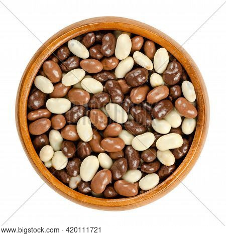 Roasted Soybeans, Coated With Chocolate, In A Wooden Bowl. Snack Of Crispy Roasted Soybeans, Covered
