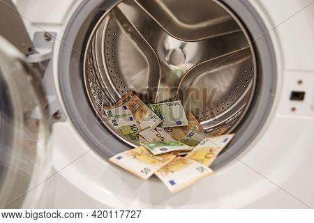 Money, Euro Washing And Laundering In Washing Machine, Closeup View.