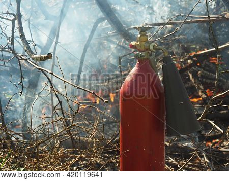 Fire Extinguisher And Forest Fire. Prolonged Drought And Fire Hazard Period. Forest And Bush Fire