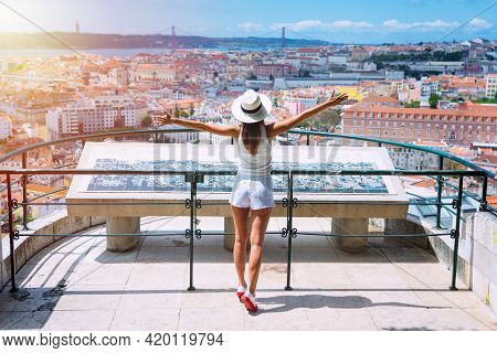 Tourist Attractions. Young Carefree Woman Tourist In White Clothes And Hat With Open Arms Enjoying T