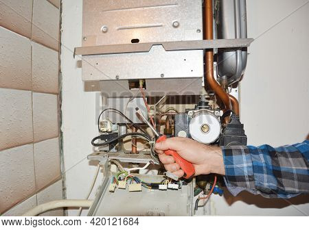 Repair And Maintenance Of A Gas Heater. Gas Heater Service: Cleaning, Fixing, Adjusting Of Gas Heate