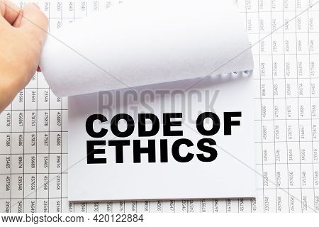 Notepad With Text Code Of Ethics On The Office Desk With Stationery. A Blank Notepad For Entering A