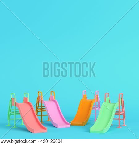 Colorful Children Slides On Bright Blue Background In Pastel Colors. Minimalism Concept. 3d Render