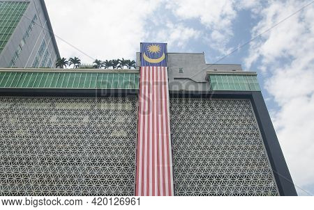 A Large Malaysian Flag Hanging Off A Building In The City Of Melaka Malaysia On A Sunny Blue Sky Day