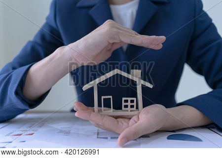 Concept Of Insurance And Protect Housing Property. Insurance Agents Or Appraisers Protect The House