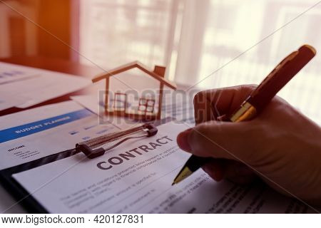 Realtor Real Estate Or Banker Writing Contract Agreement About Rent, Purchase, Loan House. Offer Of