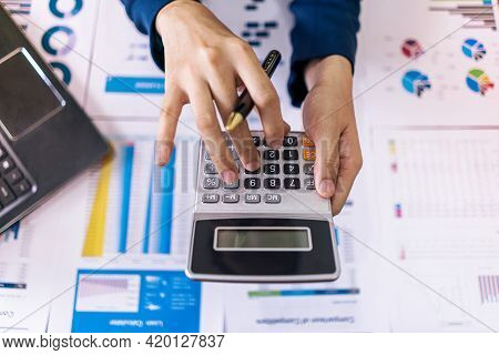 Top View. Accountant Or Business Woman Holding Calculator And Press Button Of Calculator To Calculat
