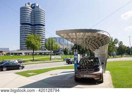 Bmw I3 Electric Car Charging In The Street Near Bmw Headquarter, May 2021, Munich, Germany
