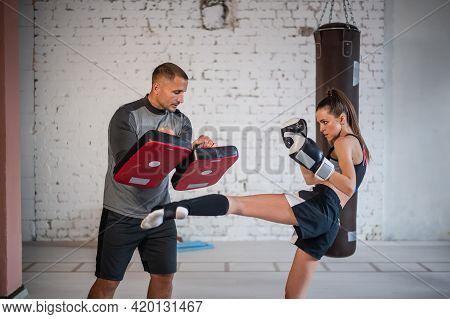 Female Martial Arts Fighter Practicing With Trainer, Punching Taekwondo Kick Pad Exercise Kicking. T