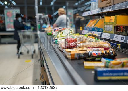 Groceries Shopping At Lidl, Checkout Cashier Counter Belt Full Of Groceries At Supermarket. Shopping
