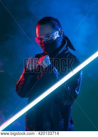 Cyberpunk Warrior. Apocalyptic Battle. Combat Woman In Face Buff Mask Glasses Ready For Fist Fight A