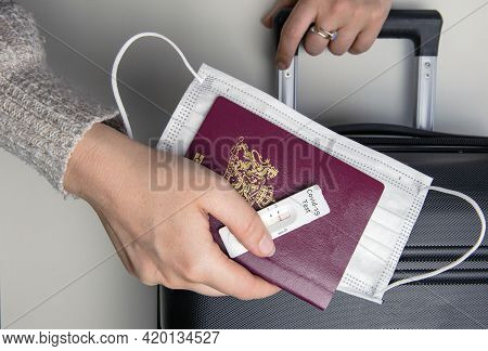 Covid-19, Travel And Lockdown Concept, Young Womans Hand With Passport,medical Mask And Negative Rap