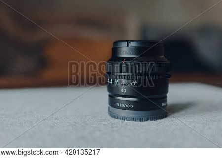 London, Uk - May 07, 2021: Close Up Of A Sony 40mm Compact Lens, Selective Focus. It Is A Part Of Ne