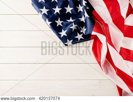 Top View Of Usa National Flag On White Wooden Background, Flat Lay