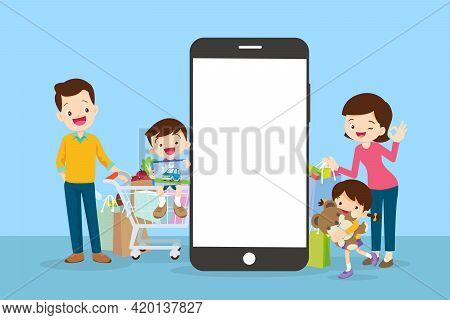 Happy Family Doing Grocery Shopping Online With A Mobile App On Their Smartphone.shopping Cart With