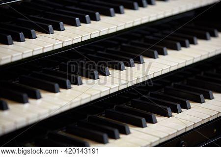 Simple Triple Pipe Organ Instrument Keyboard. Three Organ Keyboards Stack, Keys Closeup.  Detail Of