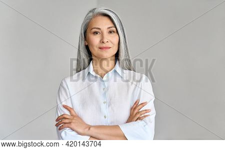 Stylish Confident Adult 50 Years Old Asian Female Psychologist Standing Arms Crossed Looking At Came
