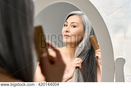 Senior Attractive Middle 50 Years Aged Asian Woman With Gray Hair Looking At Mirror Reflection Combi