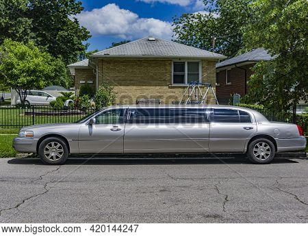 Toronto, Canada July 2017 - A Silver Colour Stretch Limousine Parked By The Sidewalk Of A Residentia