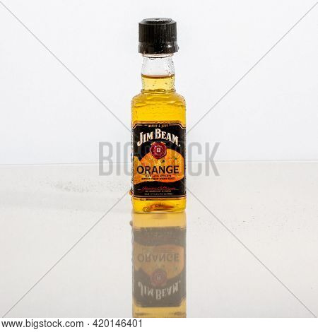Little bottle with Orange Jim Beam and reflections