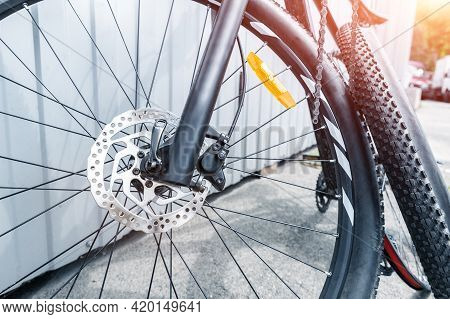 Close-up Detail Disassembled Black Carbon Fiber Bicycle With Removed Wheel And Tyre After Puncture O