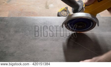 Industry Close Up Professional Hand Man Worker Cutting Tile Marble Ceramic With Circular Saw Electri