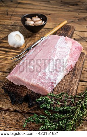Raw Pork Loin With On Wooden Board. Wooden Background. Top View