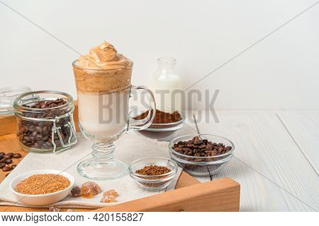 Korean Invigorating Drink With Whipped Coffee Foam And Milk On A White Background. Dalgon Coffee. Si