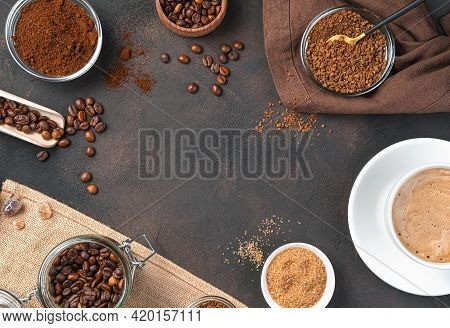 Grain, Instant And Granulated Coffee And A Cup Of Coffee On A Brown Background. Copy Space.