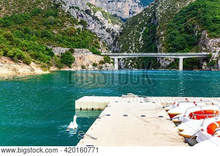 Parking for tourist catamarans. The picturesque canyon in Europe - Verdon. French Alps. The bridge connects the banks of the canyon.