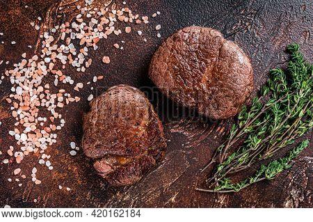 Grilled Fillet Mignon Tenderloin Meat Beef Steaks. Dark Background. Top View