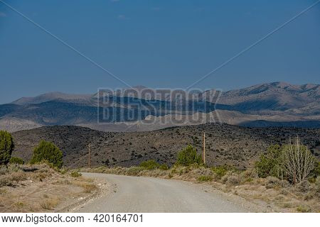 Dirt Road Heads Into The Nevada Wilderness Below Mountains Of Great Basin National Park