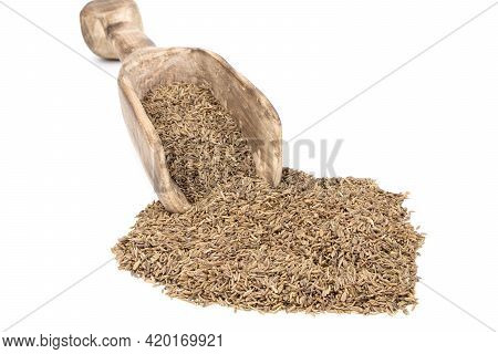 Cumin In A Wooden Spoon Isolated On A White Background. Caraway Seeds.
