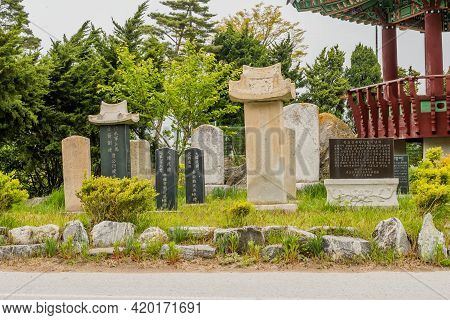Sinjindo, South Korea; April 30, 2021: Collection Of Concrete Stele And Headstones Beside Oriental P