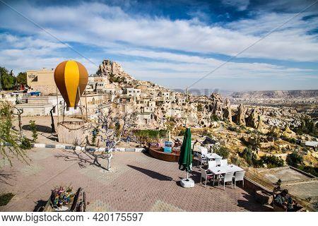 Cappadocia, Turkey - Oct 22, 2020: Cafe with looking on strange landscape with amazing rocks in Love Valley , Cappadocia, Goreme, Turkey.